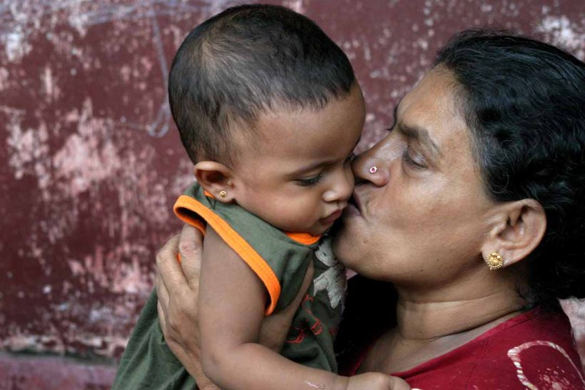 Turning the other cheek is an act of love, like this Sri Lankan woman and child