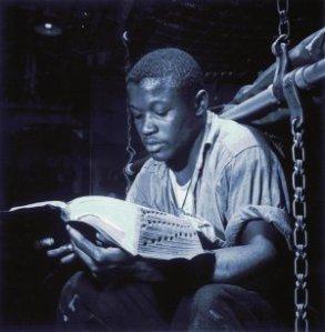 Sailor reading his Bible before battle.