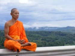 Science and Religion: Buddhist priest meditating at Watkungtaphao